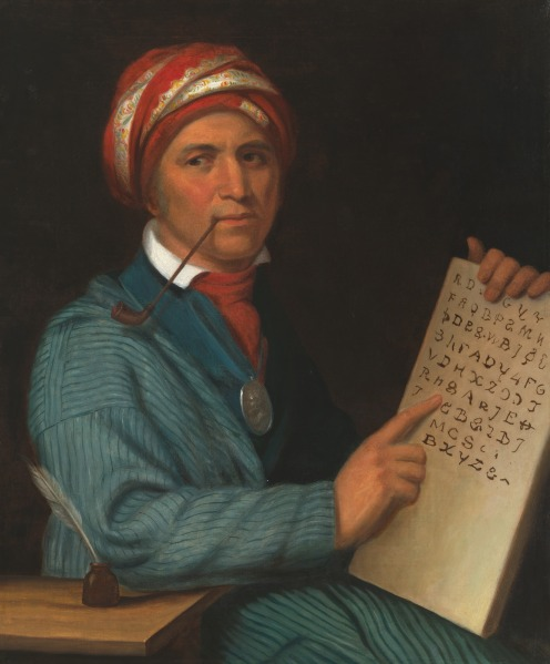 Image of Cherokee man, Sequoyah, holding a copy of his syllabary.